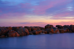 Stones in misty water at sunset Royalty Free Stock Image
