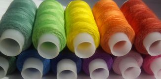 Tread spools. Rainbow of colors. Royalty Free Stock Photo