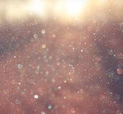 Abstract photo of light burst and glitter bokeh lights. image is blurred and filtered Royalty Free Stock Photo