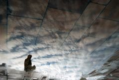 Abstract photo of a man silhouette and clouds. Water reflection Stock Images