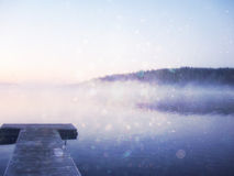 Abstract photo of misty and foggy lake at morning sunrise. Stock Photos