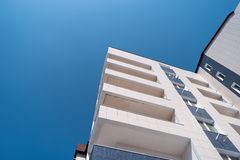 Abstract photo of a modern building and copyspaceon sky Stock Images