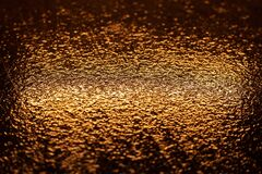 Free Abstract Photo Reflection Of Light On A Wet Surface. Yellow Neon Light On A Textured Wet Surface. Royalty Free Stock Photos - 179011438