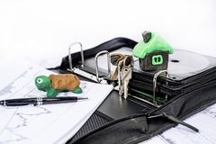 Abstract photo of slow property buying process. Documents case with turtle. Abstract photo of slow property buying process. Documents case with turtle made from stock photos