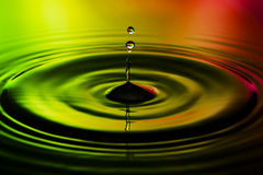 Abstract photo of water drops on nice red yellow green background. Nice texture and design photo Stock Photography