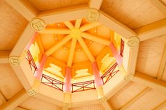 Abstract photo wooden yellow round ceiling with Asian symbols. Columns and balcony Royalty Free Stock Images