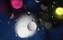 Abstract photography drops of oil on the water. Fantastic shapes of colored circles on a colorful background. Wallpaper Stock Photos