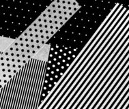 An abstract picture of black and white card. Cut out pieces of printed paper and card with black and white lines and dots royalty free stock photos
