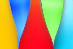 Abstract picture with color bottles. On a multi-colored background Royalty Free Stock Photography