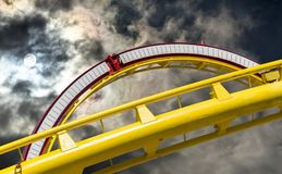 Abstract picture of the cut out part of a roller coaster in front of a dramatic sky, Germany stock image