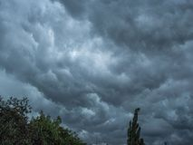 Dark blue stormy sky background texture. Abstract picture of the dark stormy clouds. Dark, Ominous Rain Clouds Promise Rain. Dark clouds sky background texture royalty free stock images