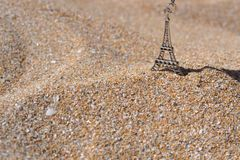 Eiffel Tower in beach sand. royalty free stock photography