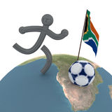 Abstract picture about soccer. Abstract picture about the World Cup in South Africa. Figure of person with the ball and the flag of South Africa Royalty Free Stock Photo