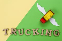 Abstract picture of a truck with wings and a word of trucking. Cargo transportation of the future. Abstract picture of a truck with wings and a word of trucking Stock Photography