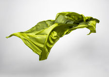 Abstract piece of green fabric flying Stock Images