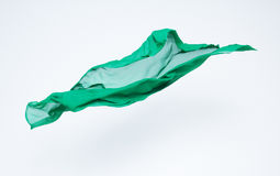 Abstract piece of green fabric flying Stock Photos