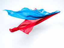 Abstract pieces of blue and red fabric flying Stock Images