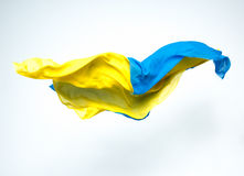Abstract pieces of blue and yellow fabric flying. Studio shot, design element Royalty Free Stock Photo