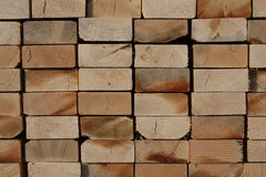 Abstract Pile Of 2x4s. Closeup of a pile of stacked wooden 2x4s for use in new home construction.  Conceptual Royalty Free Stock Photos
