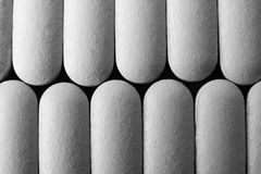 Abstract Pills. An abstract view of two rows of capsules Stock Image