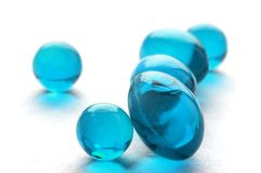 Abstract pills in cyan color. An abstract picture of vitamins pills in cyan color Royalty Free Stock Photography