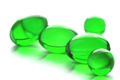 Abstract pills in green color. An abstract picture of vitamins pills in green color Royalty Free Stock Photography