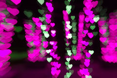 Abstract pink background bokeh of hearts for Valentine's day Royalty Free Stock Images