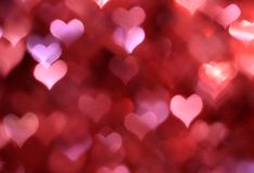 Abstract pink background with heart-shaped boke Stock Image