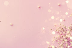 Abstract pink background. Small white flowers on pink background Royalty Free Stock Photo