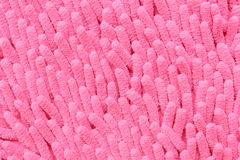 Abstract Pink coral like texture. Abstract texture of pink fabric coral like background Royalty Free Stock Photography