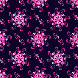 Abstract pink flowers on dark background seamless pattern vector illustration Royalty Free Stock Images