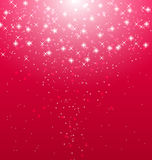 Abstract pink  illuminated background with shiny stars Stock Images