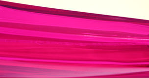 Abstract Pink Lines. Close up a pink perfume bottle Royalty Free Stock Photography