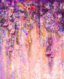 Abstract pink and violet color flowers, Watercolor painting. Han. D paint flower Wisteria tree in blossom with bokeh over light purple background. Spring flower Royalty Free Stock Photo