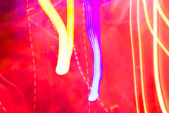 Abstract pink and yellow coloured lights unfocused background Stock Photos