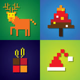 Abstract pixel icons of reindeer,christmas tree, santa claus hat Stock Image