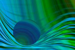 Abstract planet image. Abstract planet/ball, splashing through blue/green waves Royalty Free Stock Images