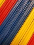 Abstract with plasticine bars in blue, yellow and red color, background and texture. School material, backdrop for ads with these colors, stripes, lines and royalty free stock photography