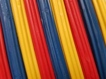 Abstract with plasticine bars in blue, yellow and red color, background and texture. School material, backdrop for ads with these colors, stripes, lines and stock image