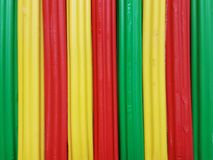 Abstract with plasticine bars in green, yellow and red color, background and texture. School material, backdrop for ads with these colors, stripes, lines and stock images