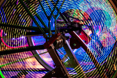Abstract play of light with lights in bicycle wheel spokes. Royalty Free Stock Photo