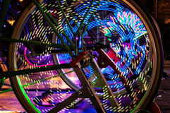 Abstract play of light with lights in bicycle wheel spokes. Royalty Free Stock Photos