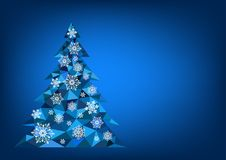 Abstract polygonal Christmas tree with snowflakes on a blue background.  Royalty Free Stock Photo