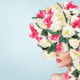Abstract portrait of young beautiful woman with flowers hairdo royalty free stock image