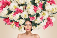 Abstract portrait of young beautiful woman with flowers hairdo royalty free stock photos