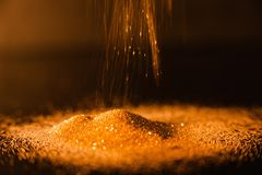 Abstract pouring glitter gold background focus Royalty Free Stock Photo