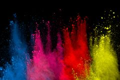 Abstract powder splatted background. Colorful powder explosion on black background. Colored cloud. Colorful dust explode. Paint Ho royalty free stock image