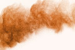 Abstract powder splatted on white background,Freeze motion of co. Abstract brown powder splatted on white background,Freeze motion of color powder exploding/ royalty free stock photos