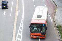 Abstract public transportation background featuring Japanese public bus service. On city street in Kanazawa, Japan stock images