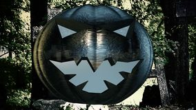 Abstract pumpkin head over the cemetery stock footage
